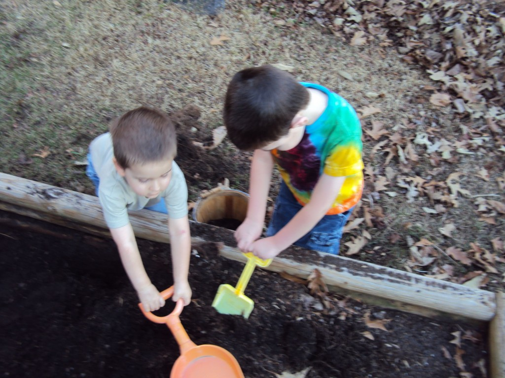 JJ and Caden shoveling dirt