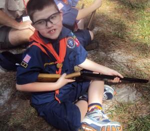 Caden shooting a Daisy BB Gun at Cub Scout Camp