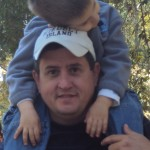 A little camper asleep on daddy's shoulders