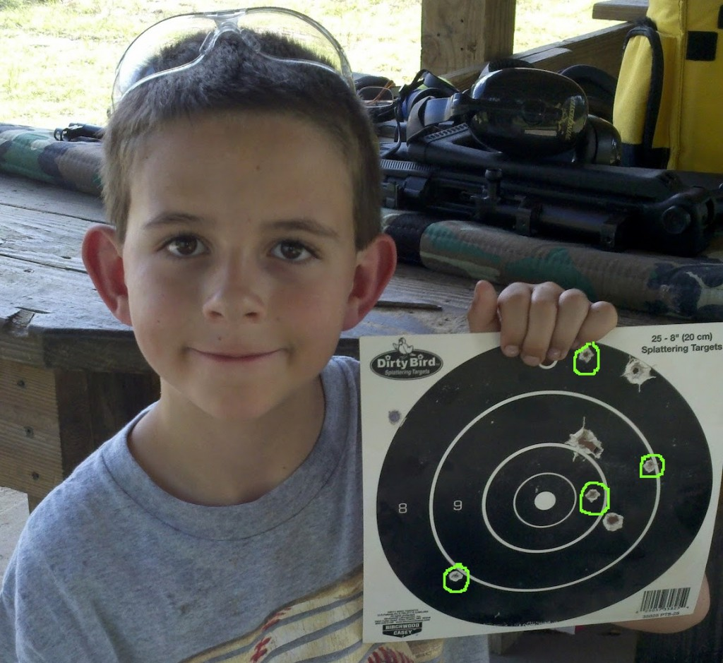 Riley with his target after his first day on the firing range