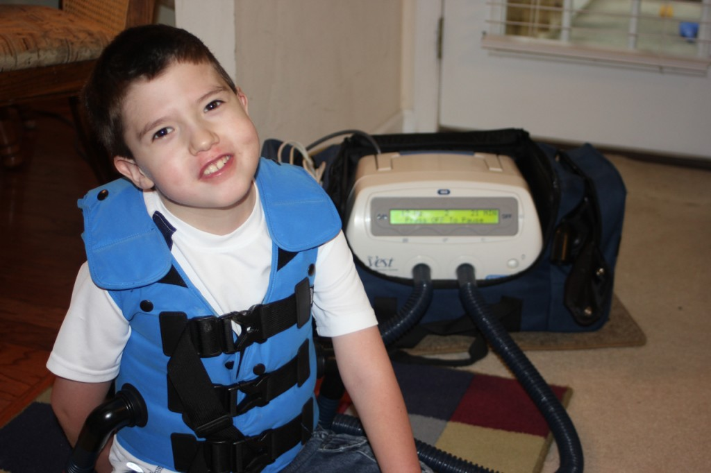 Caden using The Vest by Hill-Rom to fight pneumonia